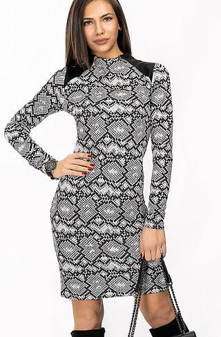 Стилна рокля с кожен акцент